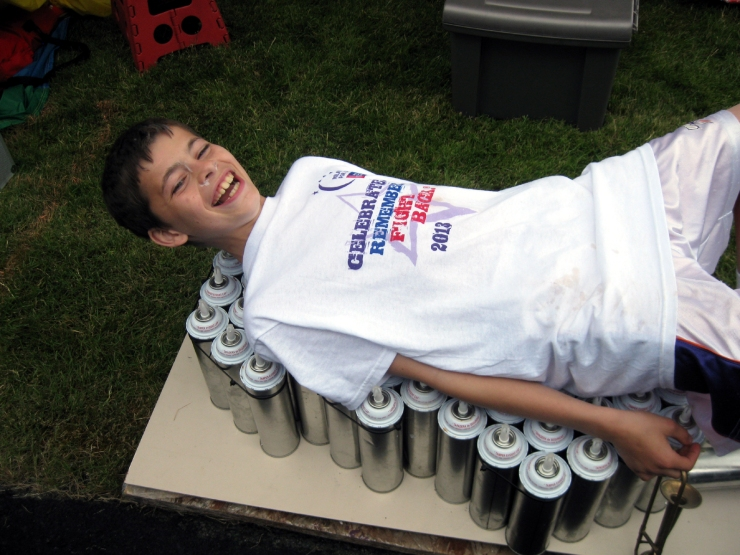 "The first brave soul  to demonstrate the mind-over-fear power of Clown Fu + Laughter Yoga on the ""Bed of Nails"""